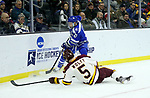 SIOUX FALLS, SD - MARCH 24: Nick Wolff #5 for Minnesota Duluth slides into the boards as Jordan Himley #10 from Air Force controls the puck during their game at the 2018 West Region Men's NCAA DI Hockey Tournament at the Denny Sanford Premier Center in Sioux Falls, SD. (Photo by Dave Eggen/Inertia)