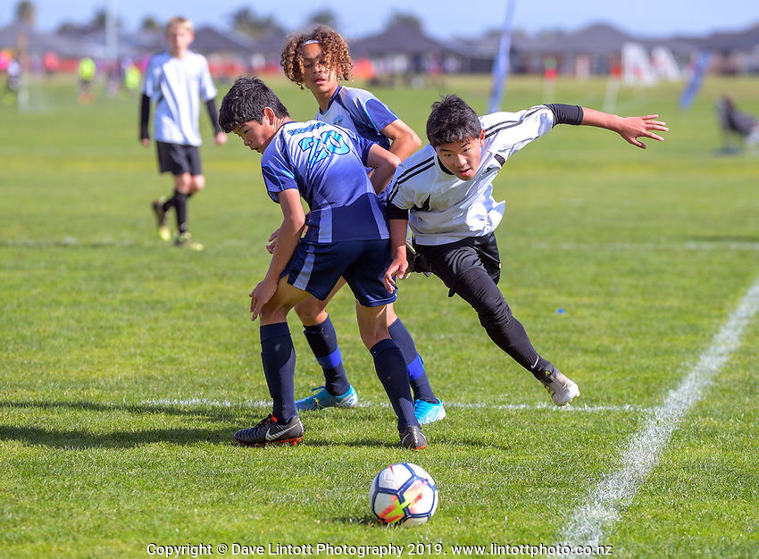 Ian Shin (Mount Maunganui Intermediate, right). Boys' football. 2019 AIMS games at Gordon Spratt Park in Papamoa, New Zealand on Thursday, 12 September 2019. Photo: Dave Lintott / lintottphoto.co.nz