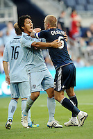 Roger Espinoza (light blue) Sporting KC and Jay DeMerit (6) Vancouver Whitecaps tassle prior to a corner kick... Sporting KC defeated Vancouver Whitecaps 2-1 at LIVESTRONG Sporting Park, Kansas City, Kanas.