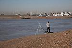 Man fishing, mouth River Deben Suffolk, England