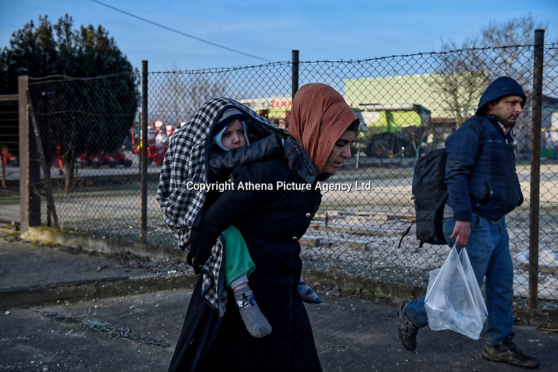 Pictured: A migrant woman carries her young child on her back in Orestiada near the Greek-Turkish border. Sunday 01 March 2020<br /> Re: Clashes between migrants and riot police at the Greek-Turkish border of Kastanies near Evros, Greece