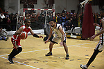 Palestinian basketball players of Khadamat al-Burij club (red T-shirt) and Khadamat al-Maghazi (white T-shirt) compete during a local competition, at Saad Sayel Stadium, in Gaza City on January 17, 2019. Photo by Mahmoud Ajjour