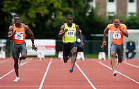 29 JUL 2009 - LOUGHBOROUGH, GBR - Leon Baptiste (centre) flanked by Harry Aikines Aryeetey (left) and Ricky Fifton (right) in the 100m Final - Loughborough European Athletics Permit Meeting.(PHOTO (C) NIGEL FARROW)
