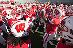Wisconsin Badgers running back Corey Clement (6) leads the team in a pregame huddle prior to an NCAA Big Ten Conference college football game against the Purdue Boilermakers Saturday, October 17, 2015, in Madison, Wis. The Badgers won 24-7. (Photo by David Stluka)
