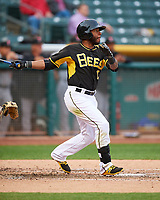 Rey Navarro (13) of the Salt Lake Bees follows through on his swing against the Fresno Grizzlies during the Pacific Coast League game at Smith's Ballpark on April 17, 2017 in Salt Lake City, Utah. The Bees defeated the Grizzlies 6-2. (Stephen Smith/Four Seam Images)
