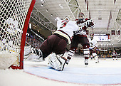 John Muse (BC - 1), Justin Braun (UMass - 27), Brian Gibbons (BC - 17) - The Boston College Eagles defeated the University of Massachusetts-Amherst Minutemen 5-2 on Saturday, March 13, 2010, at Conte Forum in Chestnut Hill, Massachusetts, to sweep their Hockey East Quarterfinals matchup.