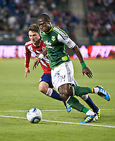 CARSON, CA – June 3, 2011: Portland Timbers midfielder James Marcelin attempts to move past Chivas USA midfielder Ben Zemanski (21) during the match between Chivas USA and Portland Timbers at the Home Depot Center in Carson, California. Final score Chivas USA 1, Portland Timbers 0.