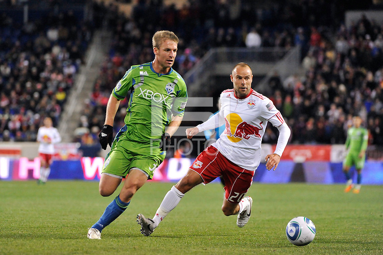 Jeff Parke (31) of the Seattle Sounders and Joel Lindpere (20) of the New York Red Bulls. The New York Red Bulls defeated the Seattle Sounders 1-0 during a Major League Soccer (MLS) match at Red Bull Arena in Harrison, NJ, on March 19, 2011.