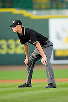 Umpire Clinton Vondrak handles the calls on the bases during the Midwest League game between the Wisconsin Timber Rattlers and the Great Lakes Loons at the Dow Diamond on May 4, 2013 in Midland, Michigan.  The Timber Rattlers defeated the Loons 6-4.  (Brian Westerholt/Four Seam Images)