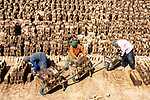 Hundreds of thousands of clay bricks are neatly piled up, baking in the 40 degree heat of a vast factory yard.  Hard bricks are stacked up, awaiting collection, whilst raw bricks are hauled down to a nearby furnace - where they are baked 100,000 at a time - at the 'Brick Kiln' in Isfahan, Iran.<br /> <br /> Workers, who are immigrants from neighbouring Afghanistan, spend 12 hours a day, using everything from tractors to wheelbarrows, transporting the bricks to the furnace.  SEE OUR COPY FOR DETAILS.<br /> <br /> Please byline: Hamid Jamshidian/Solent News<br /> <br /> © Hamid Jamshidian/Solent News & Photo Agency<br /> UK +44 (0) 2380 458800