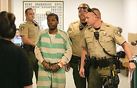 NWA Democrat-Gazette/DAVID GOTTSCHALK  Antoine Jackson is escorted Monday, May 8, 2017, from Circuit Judge Mark Lindsay's courtroom at the Washington County Courthouse in Fayetteville. Jackson plead guilty to to first degree murder for the shooting death of  Emily Nash who was found dead in her Springdale apartment May 27, 2014.
