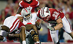 Wisconsin Badgers linebacker Culmer St.Jean (15) and defensive lineman J.J. Watt (99) sack Ohio State Buckeyes quarterback Terrelle Pryor (2) during an NCAA college football game on October 16, 2010 at Camp Randall Stadium in Madison, Wisconsin. The Badgers beat the Buckeyes 31-18. (Photo by David Stluka)