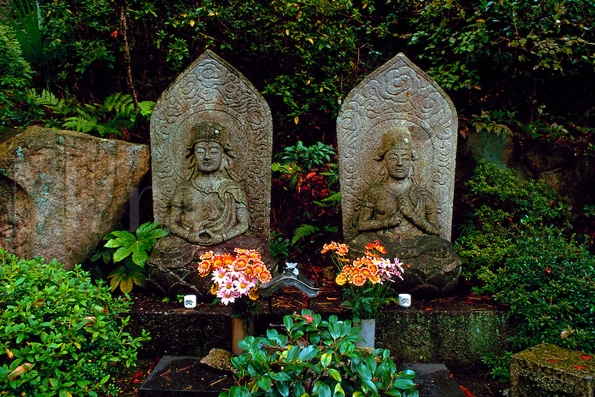 Stone sculpture of Buddhist images in temple garden, Mitakidera, Hiroshima, Japan