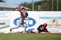 Auburn Doubledays second baseman Dalton Dulin (1) throws to first as Walker Olis (3) slides in during the first game of a doubleheader against the Batavia Muckdogs on September 4, 2016 at Dwyer Stadium in Batavia, New York.  Batavia defeated Auburn 1-0 in a continuation of a game started on August 13. (Mike Janes/Four Seam Images)