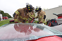 NWA Democrat-Gazette/J.T. WAMPLER Rogers firefighters train on extrication exercises Wednesday Sept. 9, 2015. The department does similar training throughout the year as opportunities allow.