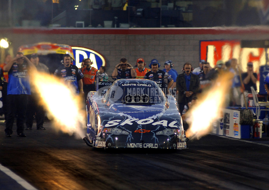 Apr 7, 2006; Las Vegas, NV, USA; NHRA Funny Car driver Tommy Johnson Jr. launches off the starting line in the Skoal Chevrolet Monte Carlo during qualifying for the Summitracing.com Nationals at Las Vegas Motor Speedway in Las Vegas, NV. Mandatory Credit: Mark J. Rebilas
