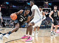 WASHINGTON, DC - JANUARY 28: Kamar Baldwin #3 of Butler powers his way past Qudus Wahab #34 of Georgetown during a game between Butler and Georgetown at Capital One Arena on January 28, 2020 in Washington, DC.