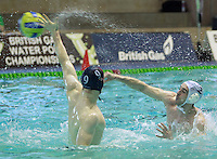 PICTURE BY CHRIS MANGNALL/SWPIX.COM - Water Polo - British Water Polo Championships 2012 - Men's Final, Manchester v Portobello - Manchester Aquatics Centre, Manchester, England - 19/02/12 - Portobello James Scobie shoots and scores against Manchester's Charles Booth..