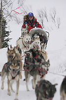 Paul Gebhart on the trail in a snowstorm shortly after leaving the Rainy Pass checkpoint.  Monday, March 7.  2005 Iditarod Sled Dog Race