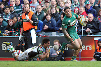 Manu Tuilagi gets past Ben Botica. Aviva Premiership semi final, between Leicester Tigers and Harlequins on May 11, 2013 at Welford Road in Leicester, England. Photo by: Patrick Khachfe / Onside Images