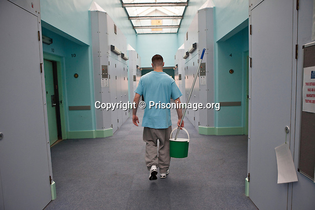 An 'enhanced' prisoner returning the mop and bucket he has used to clean his room  on H wing at the Young Offenders Institution  in Aylesbury, United Kingdom.  Under the Incentives and Earned Privilege Scheme, prisoners in the U.K. can earn extra privileges for good behaviour such as wearing their own clothes, having televisions in their cells, and having more free time to socialise.  They are often housed together in their own wing.  There are three levels of earned privileges - Basic, Standard and Enhanced.
