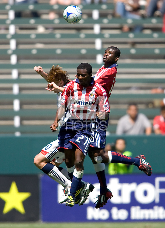 Chivas USA players Michael Lahoud (front) and Yamith Cuesta (back) battle New England Revolution forward Edgaras Jankauskas for a  ball. Chivas USA defeated the New England Revolution 2-0 at Home Depot Center stadium in Carson, California on Sunday September 13, 2009...