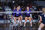 Molly Livingston (22), Haley Barnes (20), and Savannah Angel (10) of the High Point Panthers await a serve during the match against the Liberty Flames at the Millis Athletic Center on September 23, 2016 in High Point, North Carolina.  The Panthers defeated the Flames 3-1.   (Brian Westerholt/Sports On Film)