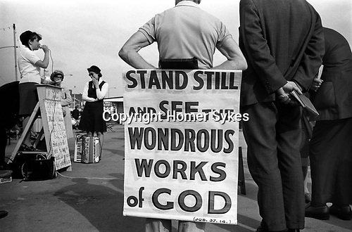 "Christian evangelical street meeting, ""Stand still and see the wondrous works of God."" Southend on Sea, Essex, England. 1974"