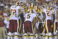 21 August 2010:  Redskins QB Donovan McNabb (5) calls a play in the huddle with rookie tackle Trent Williams (72).  The Baltimore Ravens defeated the Washington Redskins 23-3 during their preseason game 'The Battle of the Beltway' at FedEx Field in Landover, MD.