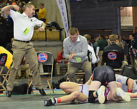 RICK PECK/SPECIAL TO MCDONALD COUNTY PRESS<br /> McDonald County wrestling coaches Josh Factor (left) and his son, Cody, celebrate Oscar Ortiz's pin of Zach Fennell of Rolla in the semifinals of the 126-pound class at the Missouri Class 3 Wrestling Championships held Feb. 14-16 in Columbia.