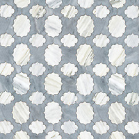 Fretwork, a stone waterjet mosaic, shown in polished Allure and Cirrus.
