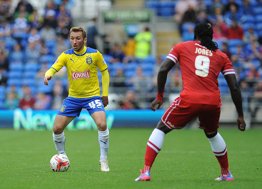 Huddersfield Town's Rados?aw Majewski in action during todays match  <br /> <br /> Photographer Ashley Crowden/CameraSport<br /> <br /> Football - Cardiff City v Huddlersfield Town - Sky Bet Championship - Saturday 16th August 2014 - Cardiff City Stadium - Cardiff <br /> <br /> &copy; CameraSport - 43 Linden Ave. Countesthorpe. Leicester. England. LE8 5PG - Tel: +44 (0) 116 277 4147 - admin@camerasport.com - www.camerasport.com