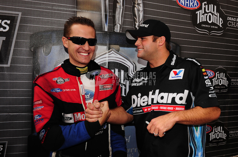 Nov. 13, 2011; Pomona, CA, USA; NHRA funny car driver Matt Hagan (right) and Bob Tasca III during the Auto Club Finals at Auto Club Raceway at Pomona. Mandatory Credit: Mark J. Rebilas-.