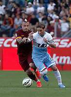 Calcio, Serie A: Lazio vs Roma. Roma, stadio Olimpico, 25 maggio 2015.<br /> Roma's Radja Nainggolan, left, is challenged by Lazio's Lucas Biglia during the Italian Serie A football match between Lazio and Roma at Rome's Olympic stadium, 25 May 2015.<br /> UPDATE IMAGES PRESS/Isabella Bonotto