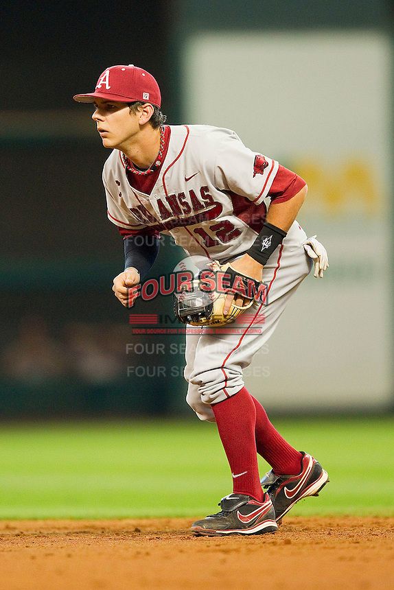 Arkansas Razorbacks second baseman Bo Bigham #12 on defense against the Houston Cougars at Minute Maid Park on March 3, 2012 in Houston, Texas.  The Cougars defeated the Razorbacks 4-1.  (Brian Westerholt/Four Seam Images)