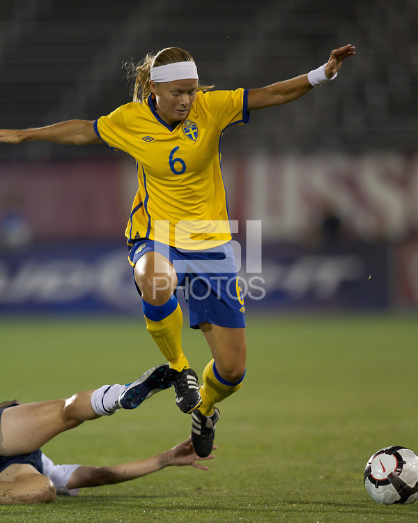 Sweden defender Sara Thunebro (6) maintains her balance after sliding tackle by US defender. The US Women's national team beat Sweden, 3-0, at Rentschler Field on July 17, 2010.