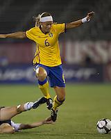 Sweden defender Sara Thunebro (6) maintains her balance after sliding tackle by US defender. The US Women's national team beat Sweden, 3-0, at Rentschler Field on July 17, 2010.