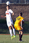TERRYVILLE CT. 17 October 2017-101717SV05-#18 Dana Mazur of Terryville heads a ball down field as #22 Andrew Colavecchio of Thomaston defends during soccer action in Terryville Wednesday.<br /> Steven Valenti Republican-American