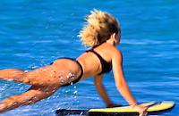 Woman bodyboarding north shore Oahu, Ehukai
