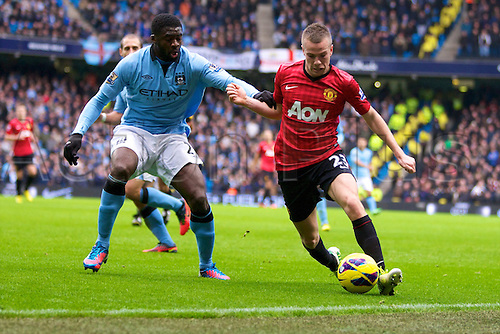 09.12.2012 Manchester, England. Manchester United's English midfielder Tom Cleverley and Manchester City's Ivory Coast defender Kolo Touré in action during the Premier League game between Manchester City and Manchester United from the Etihad Stadium. Manchester United scored a late winner to take the game 2-3.