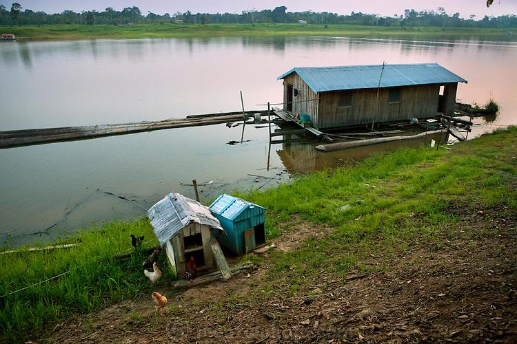 Brazilian fisherman João Agostinho Cardoso da Silva's floating home on the Salimones River in near the town of Manacapuru, Brazil.  (João Agostinho Cardoso da Silva is featured in the book What I Eat: Around the World in 80 Diets.)