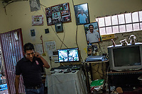 Jorge Sanchez Ordonez, son of murdered journalist Jose Moises Sanchez Cerezo, who was kidnapped on January 2, 2015, and later found murdered, walks through his home where he has a surveillance system set-up for his protection, on June 29, 2016 in Veracruz, Mexico. <br /> On January 2, 2015, Mexican social activist and journalist Mois&eacute;s S&aacute;nchez Cerezo was kidnapped from his home in Medell&iacute;n de Bravo, Veracruz, Mexico and killed. According to eyewitness reports, armed men dressed in civilian clothing broke into his house and forced him into a vehicle. The kidnappers also took S&aacute;nchez's computer, camera, and cellphones. S&aacute;nchez was the founder and director of the weekly newspaper La Uni&oacute;n, (&quot;The Union&quot;), where he covered a varierty of topics, including political corruption, government mismanagement, and organized crime. He was also active on social media as a reporter, and in his community as a taxi driver, small business owner, and neighborhood organizer. His family initially suspected that the mayor of Medell&iacute;n de Bravo, Omar Cruz Reyes, was responsible for masterminding the kidnapping because S&aacute;nchez was a harsh critic of his administration. The mayor, however, pledged his innocence and stated that S&aacute;nchez and him maintained a close friendship. On January 24, his corpse was discovered inside a plastic bag in Manlio Fabio Altamirano, Veracruz. Post-mortem examinations confirmed that his kidnappers cut his throat open and severed his head while he was still alive before mutilating his body into several pieces. Investigators believe that municipal policemen, acting on orders of the mayor, participated in the murder. S&aacute;nchez was the first journalist kidnapped and killed in Mexico in 2015.<br /> Photo Daniel Berehulak for the New York Times