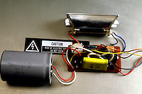 CAMERA FLASH CAPACITOR<br /> Interior elements of camera flash are extracted<br /> Capacitor is visible on the left