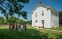 NWA Democrat-Gazette/BEN GOFF @NWABENGOFF<br /> Guests mingle outside Shiloh Meeting Hall Saturday, June 30, 2018, during a grand opening for the renovated building in downtown Springdale. Constructed in 1871, the hall served as a home to multiple church congregations, fraternal organizations and other community functions over it's lifetime. In 2005 the Independent Order of Odd Fellows donated the building to the Shiloh Museum of Ozark History for it's restoration and preservation. The restored first floor will again be used by community groups and the museum for functions, and will be available to rent for events. The second floor, expected to open in 2020, will be an exhibit hall telling the story of the building and the history of the organizations that have called it home.