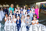 Pupils from St Olivers  NS with their teachers Charlene Brosnan nds Mary Sugrue CA at their First Holy Communion in  Church of the Ressurection on Saturday
