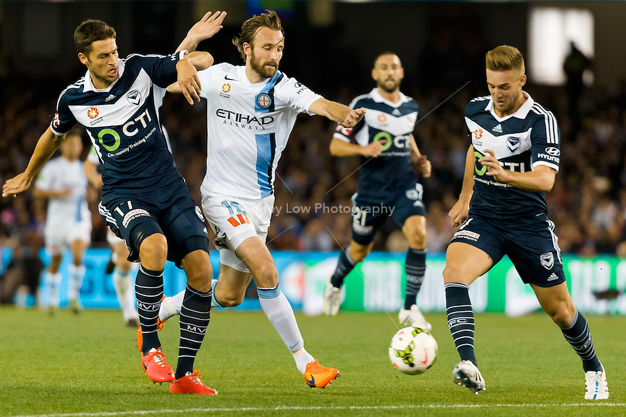 Mathieu Delpierre of the Victory and Joshua Kennedy of City fight for the ball in the semi final match between Melbourne Victory and Melbourne City in the Australian Hyundai A-League 2015 season at Etihad Stadium, Melbourne, Australia.<br /> This photo is not for sale. Contact zumapress.com for editorial licensing.