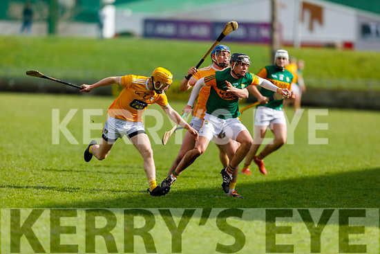 Michael Leane of Kerry tries to break free from the challenges of Gerard Walsh and Phelim Duffin of Antrim in the NHL Div 2A hurling game in Austin Stack Park on Sunday