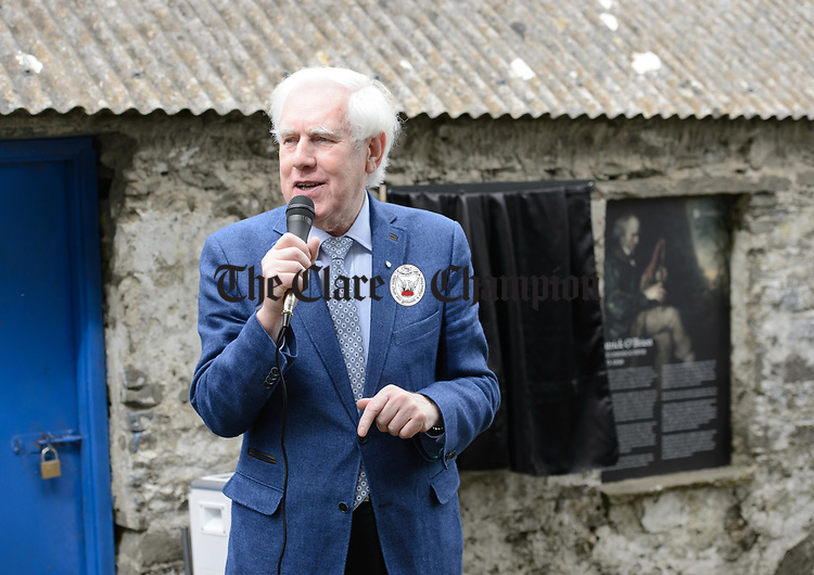 Labhrás Ó Murchú, Director-General of Comhaltas Ceoltóirí Éireann addresses the gathering at the unveiling of a memorial at the house where the blind piper Patrick O Brien was born at Labasheeda. Photograph by John Kelly.