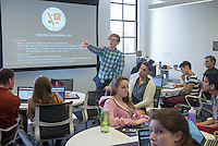 "Jacob Sargent, Associate Director, Center for Digital Liberal Arts, teaches his CSP class, ""Liberal Arts on the Brink?"" in the Varelas Innovation Lab in Johnson Hall, April 18, 2014. (Photo by Marc Campos, Occidental College Photographer)"