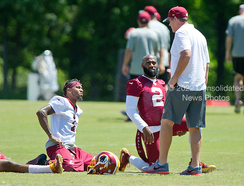 Washington Redskins wide receiver DeSean Jackson (11), wearing jersey number 1 for practice, and safety DeAngelo Hall (23), wearing jersey number 2 for practice, share conversation with head coach Jay Gruden as they participate in drills during the Veteran Minicamp at Redskins Park in Ashburn, Virginia on Tuesday, June 14, 2016.<br /> Credit: Ron Sachs / CNP